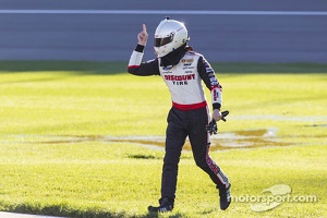 Brad Keselowski pointing with anger as Kyle Busch drives by after the crash in Kansas Nationwide race
