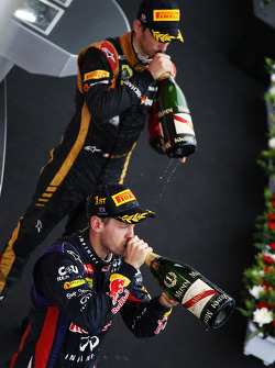 Race winner Sebastian Vettel, Red Bull Racing celebrates on the podium with third placed Romain Grosjean, Lotus F1 Team