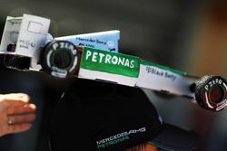 A Mercedes AMG F1 on a fans' cap