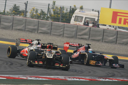 Kimi Raikkonen, Lotus F1 E21 leads Jenson Button, McLaren MP4-28 and Jean-Eric Vergne, Scuderia Toro Rosso STR8