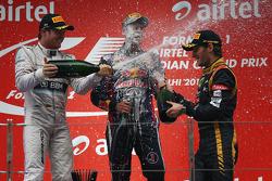 Podium: 1. Sebastian Vettel; 2. Nico Rosberg; 3. Romain Grosjean