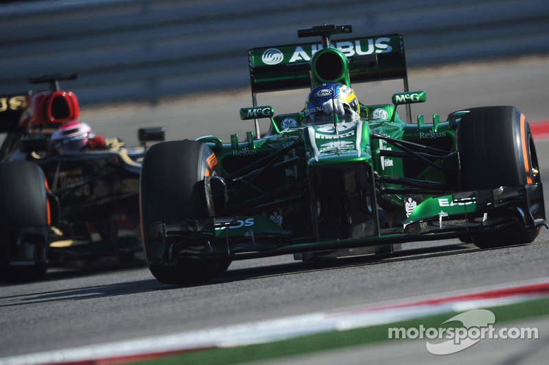 Charles Pic, Caterham CT03 leads Heikki Kovalainen, Lotus F1 E21