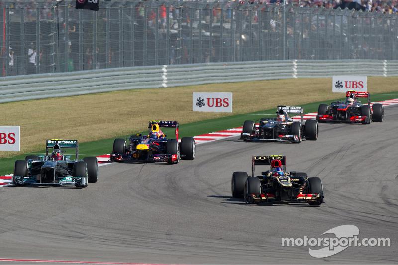 Romain Grosjean, Lotus F1 E21 y Lewis Hamilton, Mercedes AMG F1 W04