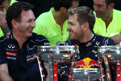 (L to R): Christian Horner, Red Bull Racing Team Principal and race winner Sebastian Vettel, Red Bull Racing celebrate with the team
