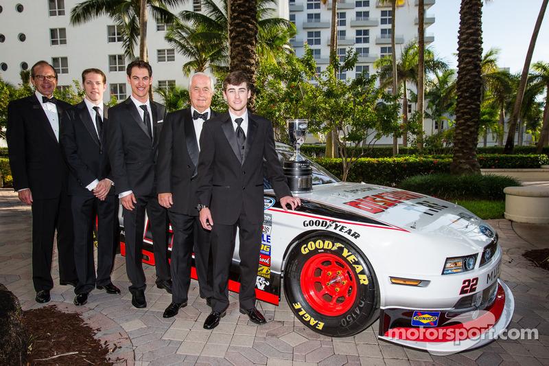 NASCAR Nationwide Series champion owner Roger Penske poses with drivers Brad Keselowski, Ryan Blaney and Joey Logano