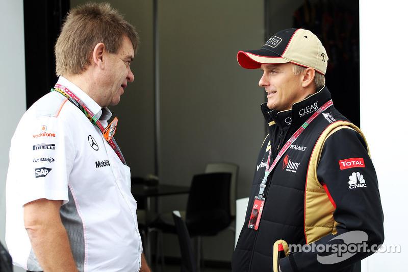 (L to R): Dr. Aki Hintsa, McLaren Team Doctor with Heikki Kovalainen, Lotus F1 Team