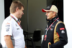 (L to R): Dr. Aki Hintsa, McLaren Team Doctor with Heikki Kovalainen, Lotus F1 Team
