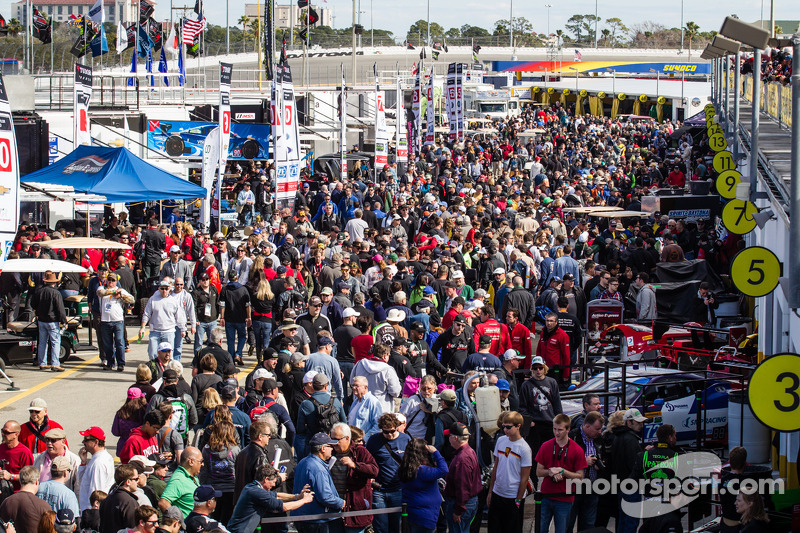 A huge crowd in the garage area