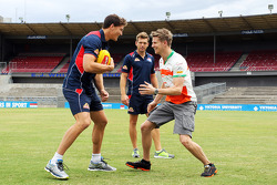 Nico Hulkenberg, Sahara Force India F1 practices his Aussie Rules skills on Will Minson, Western Bul