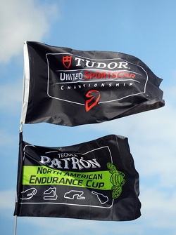TUDOR United SportsCar Championship and Patron NAEC flags in the paddock