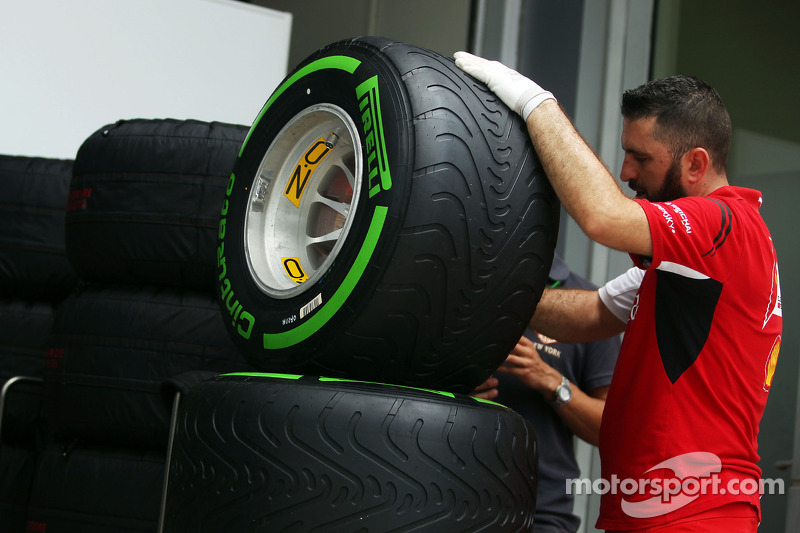 Ferrari mechanic prepares intermediate Pirelli tyres