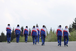 The Toyota team walks the track