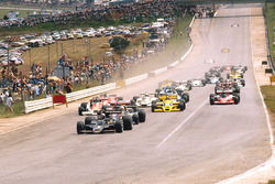 Mario Andretti, Lotus 78 Ford leads Jody Scheckter, Wolf WR1 Ford, Nikim Lauda, Brabham BT46 Alfa Romeo and James Hunt, McLaren M26 Ford, at the start
