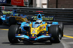 Fernando Alonso, Renault R26 leads team mate Giancarlo Fisichella, Renault R26
