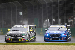 Craig Lowndes, Triple Eight Race Engineering Holden, leads Tim Blanchard, Brad Jones Racing Holden