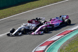 Charles Leclerc, Sauber C37 and Sergio Perez, Force India VJM11