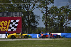 #86 TA Ford Mustang, John Baucom of Baucom Motorsports and the #33 TA Chevrolet Corvette, Daniel Urrutia Jr. of Ferrea Racing Components sit on the runoff by the hairpin after separate incidents.