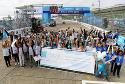 Susie Wolff, founder of Dare to be Different, with the girls of Dare to be Different in the pits