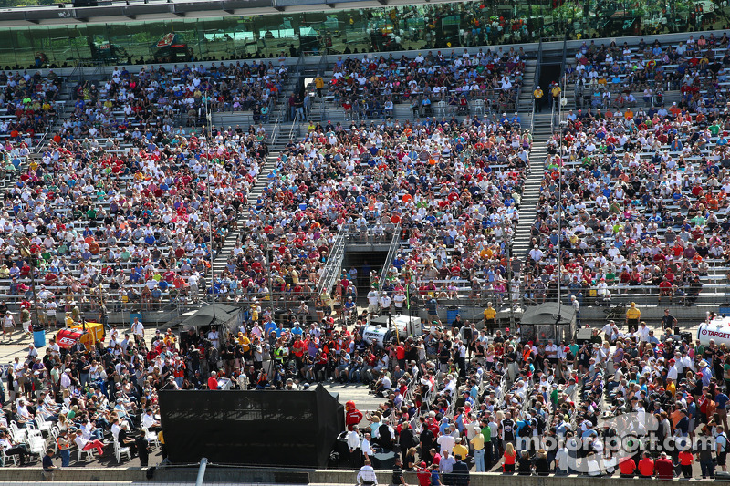 Fans watch the public drivers meeting