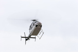 Kurt Busch arrives by helicopter from the Indy 500