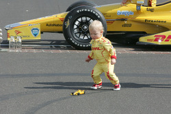 Young Ryden Hunter-Reay plays with a replica of his dad's race car during the winner's photo shoot