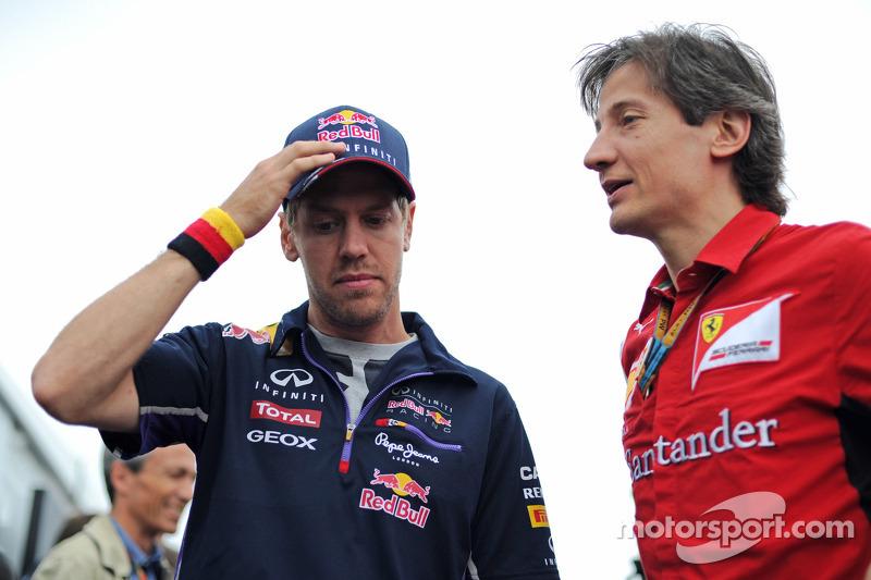 (L to R): Sebastian Vettel, Red Bull Racing with Massimo Rivola, Ferrari Sporting Director
