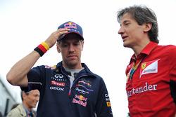 Sebastian Vettel, Red Bull Racing con Massimo Rivola, Ferrari director deportivo