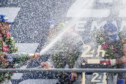 LMP1-H podium: class and overall winners Marcel Fässler, Andre Lotterer, Benoit Tréluyer spray champagne