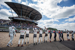 Mercedes-AMG drivers salute the fans at the Mercedes-Benz grandstand