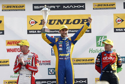 Podium: race winner Andrew Jordan, second place Rob Collard, third place Gordon Shedden