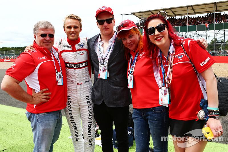 Dr. Vijay Malyaei Cheglakov, Marussia Team Owner on the grid with Max Chilton, Marussia F1 Team; Sasha Cheglakov, Marussia Team Owner; Anya Cheglakov