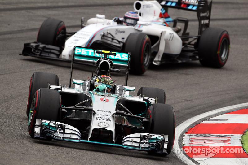 Nico Rosberg, Mercedes AMG F1 W05 leads Valtteri Bottas, Williams FW36