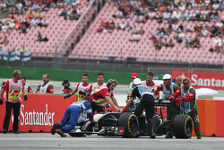Marshals recover the Sauber C33 of Adrian Sutil, Sauber, who spun and retired from the race