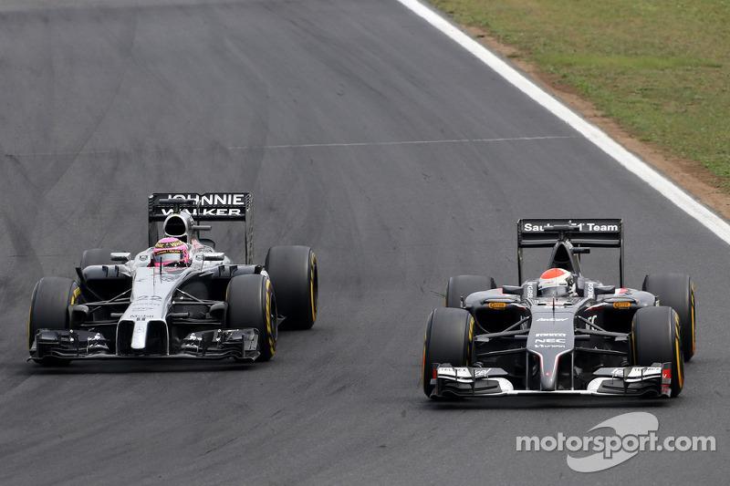 Jenson Button, McLaren F1 Team; Adrian Sutil, Sauber F1 Team