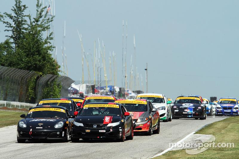#04 Autometrics Motorsports Porsche Cayman: Adam Isman, Remo Ruscitti e #93 HART Honda Civic SI: Chad Gilsinger, Michael Valiante batalham pela ponta no começo da prova