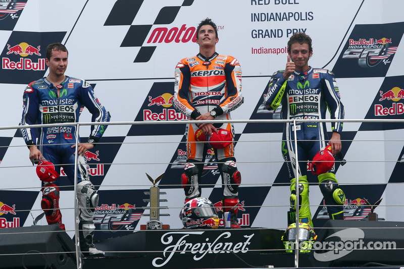 Podium: race winner Marc Marquez, second place Jorge Lorenzo, third place Valentino Rossi