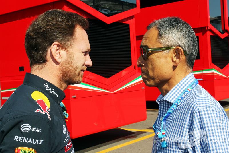 (L to R): Christian Horner, Red Bull Racing Team Principal with Hiroshi Yasukawa, Dorna Sports Adviser