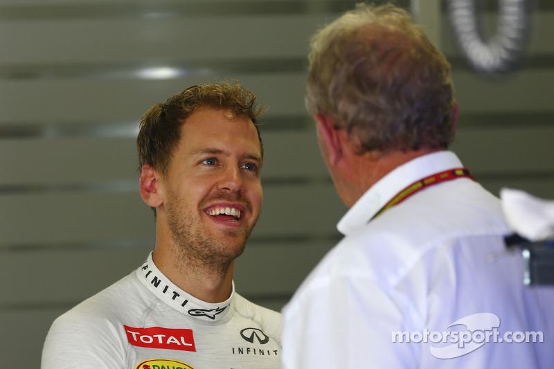 (L to R): Sebastian Vettel, Red Bull Racing with Dr Helmut Marko, Red Bull Motorsport Consultant