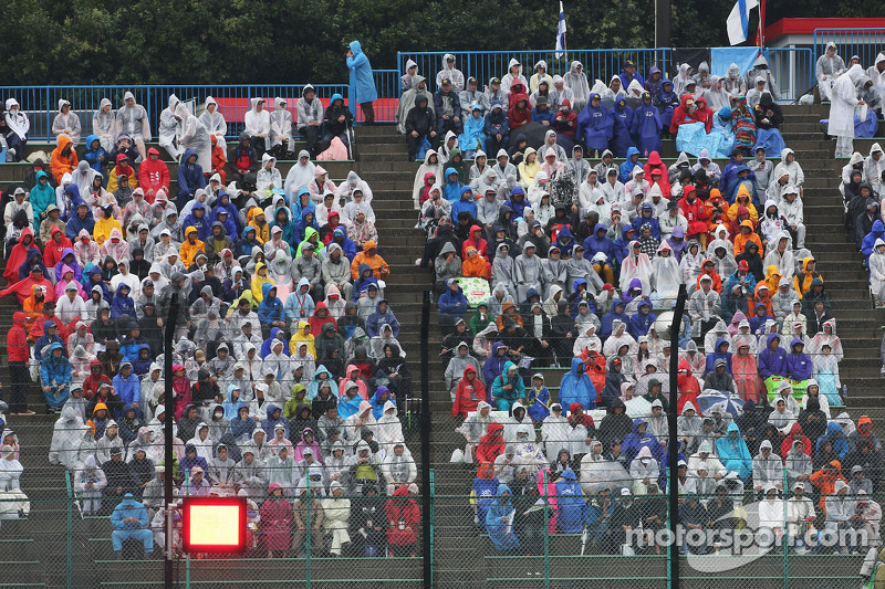 Fans in the grandstand as the race is stopped