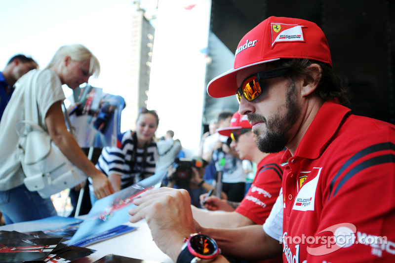Fernando Alonso, Ferrari signs autographs for the fans at the Fanzone