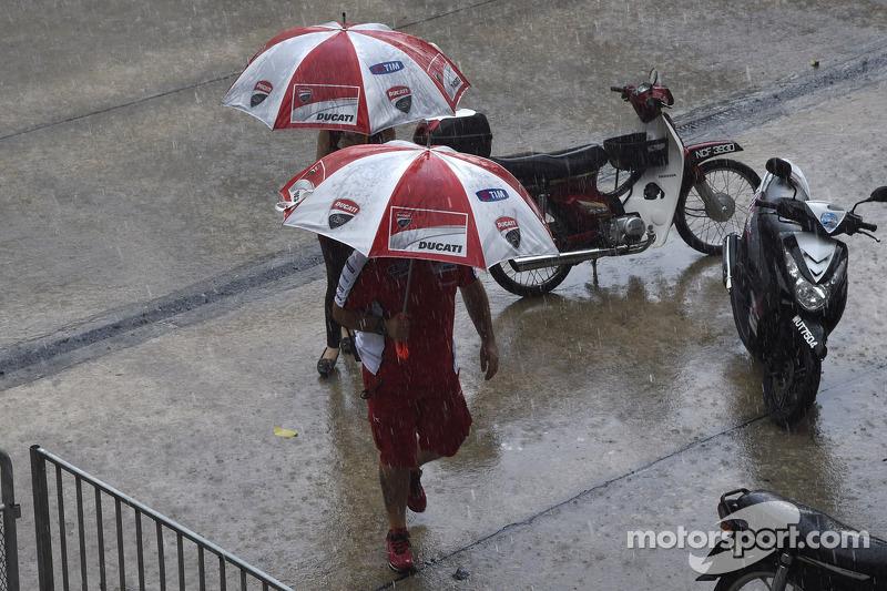 Ducati team members in the rain