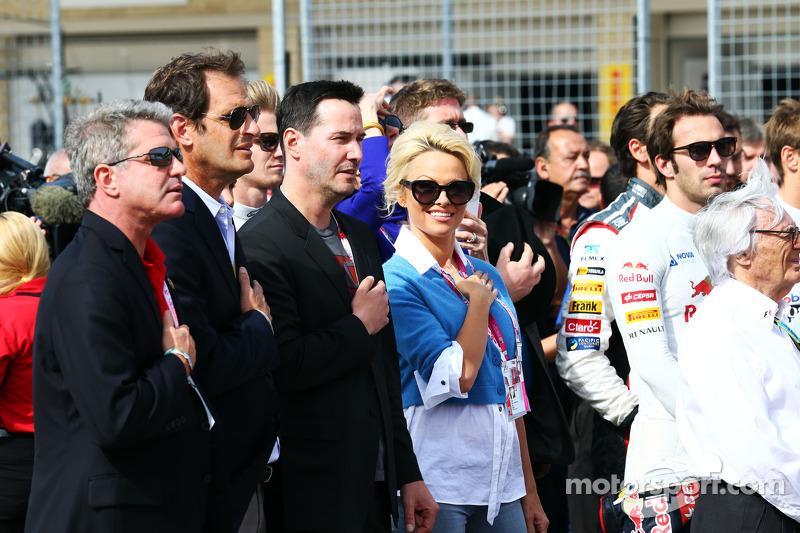 Keanu Reeves, ator e Pamela Anderson, atriz, no grid