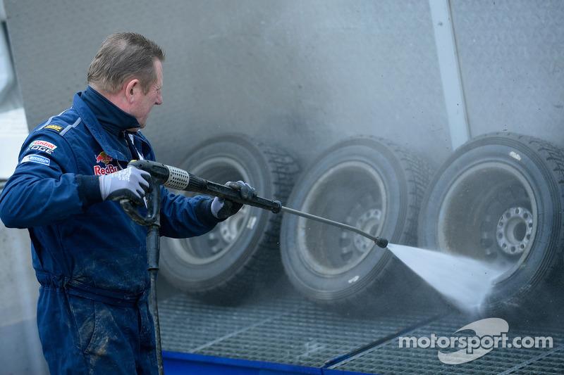 A Volkswagen mechanic cleaning wheels