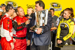 Race winner and 2014 NASCAR Sprint Cup series champion Kevin Harvick, Stewart-Haas Racing Chevrolet accepts the Sprint Cup from NASCAR President Mike Helton