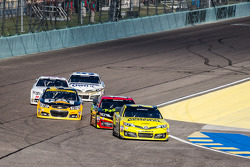 Matt Kenseth, Joe Gibbs Racing Toyota and others wait at pit exit for session restart