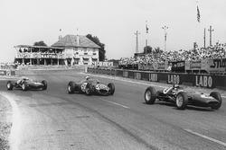 Jim Clark, Lotus 21-Climax, leads Giancarlo Baghetti, Ferrari Dino 156, and Innes Ireland, Lotus 21-Climax