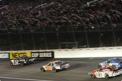 Ryan Newman leads Robby Gordon