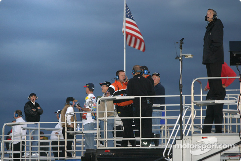 Crew chiefs monitor happy hour from atop the team transporters