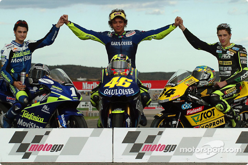 The 2004 champions: MotoGP 500cc champion Valentino Rossi, with 250cc champion Daniel Pedrosa ...