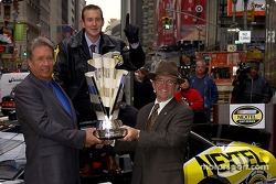 Jimmy Fennig, Kurt Busch and Jack Roush pose with the Nextel Cup in Times Square